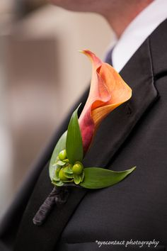 Groom, groomsmen's colourful boutonniere - orange lily. photo: www.eyecontact.ca