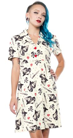 SOURPUSS SWASHBUCKLER ROSIE DRESS - Arrrr, mateys! This new Swashbuckler Rosie Dress features some badass female pirates, courtesy of artist, Gakni Gallo. Our Rosie Dress is an ever-popular silhouette, reminiscent of the 1940s with a figure flattering a-line skirt and large, contrast buttons on the chest. Our little flag label on the left sleeve adds the perfect finishing touch!