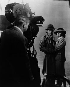 """Humphrey Bogart & Ingrid Bergman on the set of Michael Curtiz's """"Casablanca."""" 1942. Set in unoccupied Africa during the early days of World War II: An American expatriate meets a former lover, with unforeseen complications."""