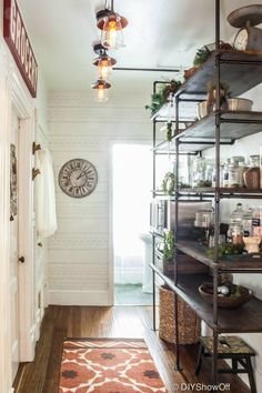 modern, vintage, eclectic farmhouse kitchen makeover and industrial pipe shelving in open pantry at diyshowoff.com