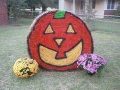 Hay bale Halloween yard decoration.  See more decorations and Halloween party ideas at one-stop-party-ideas.com