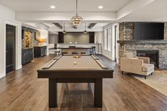Luxurious urban farmhouse in Ohio offers delightful entertaining spaces #pooltable #gameroom #farmhouse Cozy Basement, Basement Bedrooms, Basement Ideas, Wooden Beams Ceiling, Casual Family Rooms, Cambria Countertops, Urban Farmhouse, Types Of Rooms, Basement Renovations