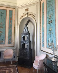 I love the 18th c. blue wall panels + the iron stove (from Norway) typical of Danish country houses
