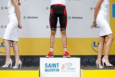 Branding via sports & social media >>> Podium hostesses walk off the stage as American Tejay van Garderen, wearing the best young rider's white jersey, celebrates on the podium of the fifth stage in Saint-Quentin on July 5, 2012. (Laurent Cipriani/Associated Press) #