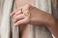Infinity necklace combined with a Lingonberry trio set of Rings. 24K gold plated on Recycled Sterling Silver. Swedish design, hand made with Love in Bali. Conscious jewels!