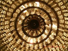 Radial Balance -- the crystals around the chandelier are spread near equally from each other in a circular pattern around the center point of the photo.