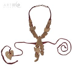 Necklace-bodice realized with platan bark, elastic bordeaux cotton strings and copper finish. The strips must be knotted behind one's back. Buy it on ArtEco's Etsy shop! https://www.etsy.com/listing/201701826/necklace-bodice-realized-with-platan