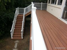 90 foot long Trex Tiki Torch deck with stairs.