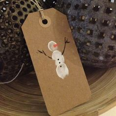 DIY::Fingerprint gift tags..fun craft for kids to do to help when wrapping holiday gifts.