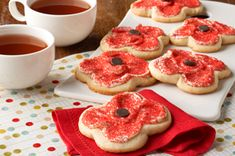 Remembrance Day Poppy Cookies: Vanilla frosting perfectly complements the soft cream cheese cookies, and red sugar makes the flower pop! These cookies are a perfect treat to share with friends as we remember those who served this country. Cream Cheese Cookies, Cookies Et Biscuits, Sugar Cookies, Cookie Recipes, Dessert Recipes, Desserts, Remembrance Day Poppy, Philadelphia Recipes, Big Cakes