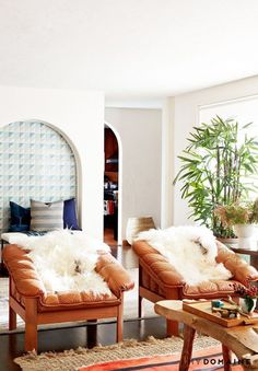 Living space with two leather amrchairs, lamb throws, and a shag rug