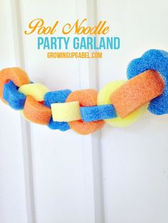 Looking for pool party decoration ideas? Make this fun and colorful pool noodle garland! Use dollar store pool noodles to make this quick and easy craft!