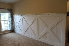 Finished Barn Door Wainscoting Wall Treatment With Ledge Topper