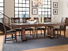 Intercon Hayden Dining Set - Enjoy this dining set with silver plated feet with an easy leaf extension. Can accommodate up to 10 chairs.
