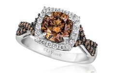 How do you like this chocolate treat of an engagement ring? The 14k Vanilla Gold ring from Le Vian Bridal features a Chocolate diamond, with 0.56 cts. t.w. Vanilla Diamond accents set in a cushion-shape frame around the round center and Chocolate Diamond accents along the twirling band. Truly a mouth-watering jewel not only for serious chocolate-lovers! www.diamonds.pro