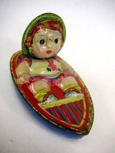 Japanese Vintage 1950 Lifting Straw Hat Girl In Boat Tin Toy