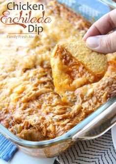 With just a few pantry staples, you can have a batch of amazing Cheesy Chicken Enchilada Dip thrown together in no time. This crowd pleasing dip is creamy, cheesy, and super filling, thanks to the shredded chicken! Chicken Enchilada Dip, Cheesy Chicken Enchiladas, Enchilada Sauce, Dip Recipes, Mexican Food Recipes, Cooking Recipes, Mexican Dishes, Recipies, Yummy Appetizers