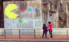 PAC-MAN (made of ceramic tiles and created by the French Street Artist, Invader) appears on a wall along King's Road near Fortress Hill in Hong Kong - subsequently REMOVED by the local government.
