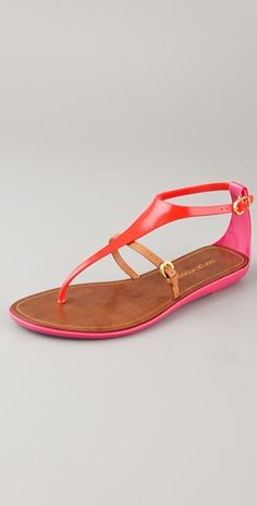 Colorblock rubber T-strap sandals feature a buckled leather strap at the vamp and a buckled strap closure at the ankle. Leather footbed and sliver wedge heel.