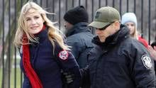 Actress Daryl Hannah is arrested outside the White House in Washington, Wednesday, Feb. 13, 2013, as prominent environmental leaders tied themselves to the White House gate to protest the Keystone XL oil pipeline. (Ann Heisenfelt /AP)