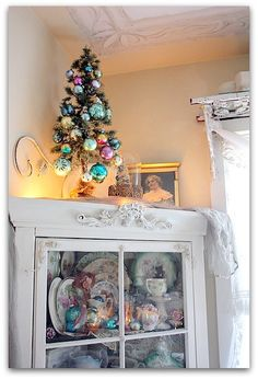 Cute little Christmas tree with vintage ornaments