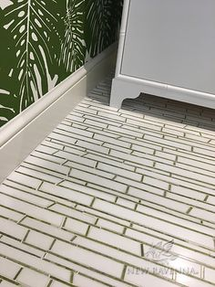 Bamboo, a hand-cut stone mosaic, shown in polished Thassos and Chatreuse, is part of the Metamorphosis Collection by Sara Baldwin for New Ravenna Mosaics.