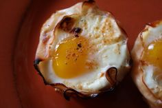 Yumm.  Try with Turkey?  Line a muffin tin with slices of ham. Crack an egg into each muffin spot, and season with salt, pepper, and paprika.  Bake at 375ºF for 20 minutes