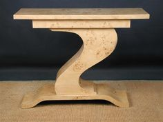 Beautiful lines...20th century burr maple console table. Do the same with wood.