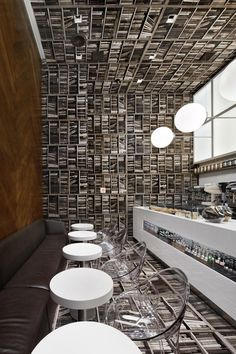 Above: Floor-to-ceiling in the most literal sense: bookshelf-printed wallpaper at D'Espresso in New York.