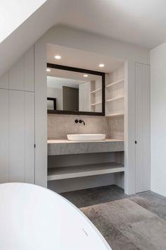 Modern bathroom. Grey stone, concrete, white cabinets
