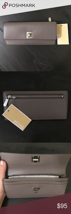 Michael Kors Wallet NWT Brand new, never been used Michael Kors Wallet. It's kind of a deep purplish gray color. Has 8 card slots and a roomy coin purse on the back. Beautiful wallet, just a bit too big for my taste! Michael Kors Bags Wallets