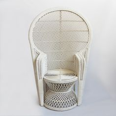 Classic hand weaved Rattan Peacock Chair in a smooth white finish. Includes removable white canvas cushion.