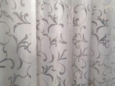 tessuto per #tendaggi di colore bianco con motivo floreale semitrasparente. #tendeonline #arredamentomoderno