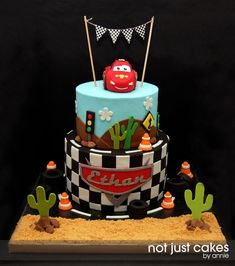 Lightning McQueen Cake this is a LOT more work (Oscar's Thomas one took me 15 hours!) die cast car on top. would be more expensive!!!