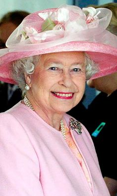 Queen Elizabeth was a pink lady in darling spring hat during a meeting with the staff at the Dover Ferry terminal in Dover, Kent.