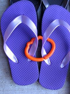 Why Have I Never Thought Of This? use those old  baby rings to keep flip flops together