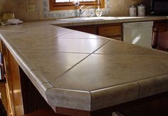 I like tiled countertops....especially like the use of thes larger tiles on an angle