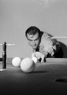 Sean Connery, aka James Bond, enjoying a game of bar billiards in his basement flat in London, 1962