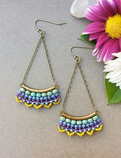 These lightweight earrings are a Mile High Beads original design. They are hand-woven with needle and thread using turquoise, periwinkle, purple, and yellow Czech and Japanese seed beads, antique brass-plated tubes, and antique brass-plated chain. These earrings measure approximately