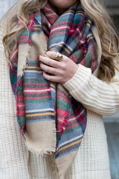 Fall plaid paired with a sweater and cute rings for your fingers! Layering is everywhere this time of year