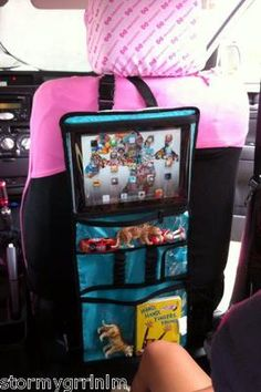 Thirty One Gifts Timeless Beauty Bag used in car as seat back entertainment!  Check out the new fall catalog, ask questions and place orders at my website mythirtyone.com/368777/