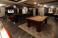 Game Room with flush light, Built-in bookshelf, Regal Retro Fountain 30 in. Metal Bar Stool with Chrome Seat Edge Man Cave Bar, Regal Retro, Garage Design, House Design, Man Cave Basement, Basement Movie Room, Basement House, Basement Walls, Modern Basement