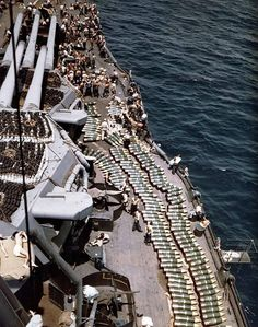 14-inch (35.6 cm) projectiles on deck of the U.S. Navy battleship USS New Mexico (BB-40) while the battleship was replenishing her ammunition supply prior to the invasion of Guam July 1944.