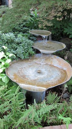 a tiered birdbath among the greenery offers water song and whimsy. (indoor pond)