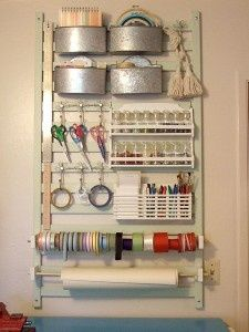 How to make a craft and tool station.  Supplies: salvaged railing (from an old crib, porch railing, etc.) wood screws,16- or 18-gauge wire (or a wire coat hanger), 3/8-inch dowels, power strip, nuts, washers, and bolts, primer, paint, scrap 1×4 piece of wood, newspaper or drop cloth, drywall anchors or molly | http://amimestuffs.blogspot.com