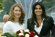 Tennis great Steffi Graf of Germany (left) and Gabriela Sabatini of Argentina pose for photographers in the newly-named 'Steffi Graf Stadium' in Berlin, on September 25, 2004. Just prior to renaming the stadium, Steffi beat Sabatini in an exhibition match by a score of 6-1, 7-5. Proceeds from her match against Sabatini went to Steffi's foundation, 'Children for tomorrow.'