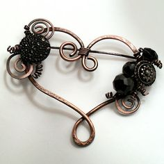 copper and antique glass buttons