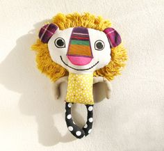 Grinner Plush Lion, recycled fabrics by katkalandcreatures on etsy: http://www.etsy.com/listing/94661710/grinner-plush-lion-recycled-fabrics