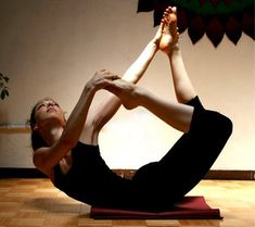 What an interesting variation of bow pose. Enjoyed and repinned by yogapad.com.au