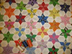 60 degree diamonds, 6 pieced star with one inch sides, one inch side hexigon, no pattern named quilt